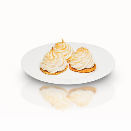 lite food: three meringue cake on a plate