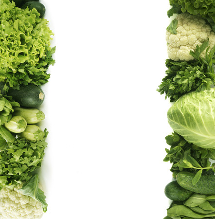 Parsley, spinach, cucumber, cauliflower, zucchini, arugula, cabbage, mint and lettuce. Top view. Green vegetables at border of image with copy space for text. Green vegetable on white background.