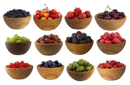 Collage of different fruits and berries isolated on white. Set of strawberries, raspberries, currants, blackberries, gooseberries, grapes, bilberries and cherries. Sweet and juicy berry with copy space for text. Ripe strawberries close-up. Background berr Фото со стока