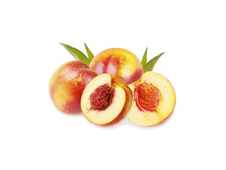 Peaches (nectarine) isolated on white background. Peaches with leaves. Stock Photo