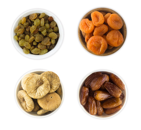 Collage of different dried fruits. Raisins, dates, dried apricots, figs isolated on white background. Top view. Archivio Fotografico