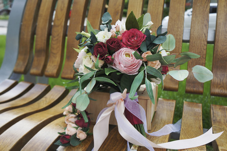 Artificial flowers made from sponge rubber. Bouquet for the bride. Foam-iran. Beautiful colorful wedding bouquet. Handmade flower fabric foamiran.