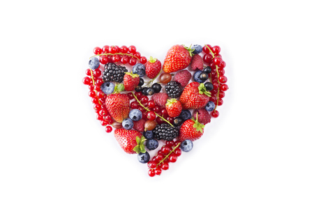 Heart shape assorted berry fruits on white background. Archivio Fotografico