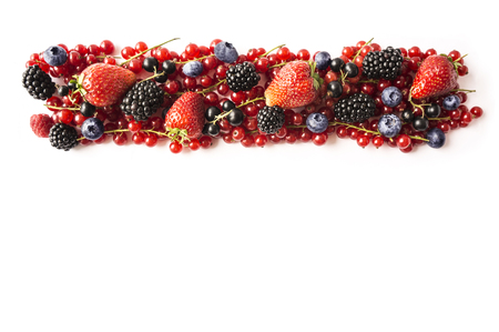 Mix berries isolated on a white background. Ripe red currants, strawberries, blackberries, blueberries, blackcurrants on white background. Top view. Fruits with copy space for text. Black-blue and red food.