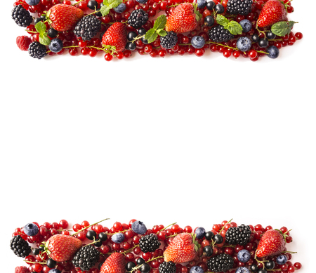 Mix berries on a white background. Ripe red currants, strawberries, blackberries, blueberries, blackcurrants on white background. Top view. Fruits with copy space for text. Black-blue and red food. Imagens