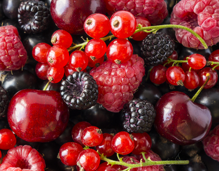 Ripe blackberries, blackcurrants, cherries, red currants and raspberries. Mix berries and fruits. Top view. Background berries and fruits. Various fresh summer fruits.