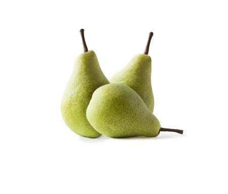 Ripe pears isolated on a white background. Pears with copy space for text. Green pears close-up. Three pears on white background.