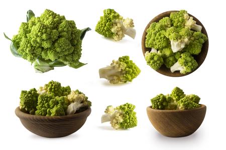 Set of Roman cauliflower. Roman cauliflower on wooden bowl isolated on white. Roman cauliflower close up. Fractal texture of romanesco broccoli. Roman cauliflower with copy space for text. Banco de Imagens