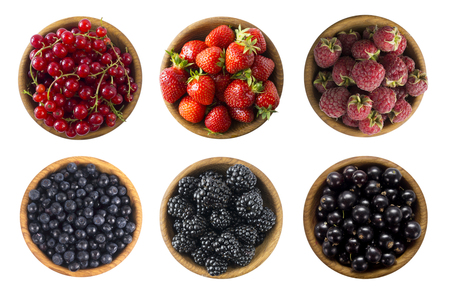 Red and black food. Berries and fruits isolated on white background. Collage of different fruits and berries at black and red color. Raspberries, strawberries, red currants, blackberries, bilberries and black currants. Top view. Various fresh summer on white background. Archivio Fotografico