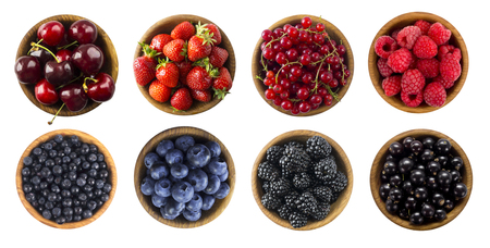 Red and blue food. Berries and fruits isolated on white background. Collage of different fruits and berries at green and red color. Raspberries, strawberries, currants, cherries, blueberries, bilberries and blackberries. Top view. Various fresh summer on white background.