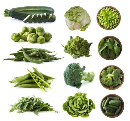 Various green vegetables isolated on white background. Zucchini, green beans, brussels sprouts, green peas, broccoli, cabbage Romanesco, white cabbage on white. Vegetables isolated on a white background. Vegetables with copy space for text.