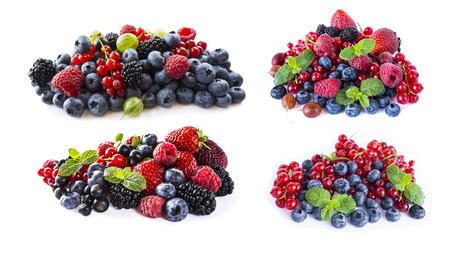 Berries and fruits isolated on white background. Ripe blueberries, blackberries, blackcurrants, raspberries, gooseberries, strawberries and red currants. Mix fruits on white background. Mix berries with copy space for text. Various fresh summer berry. Black-blue and red berries on white.