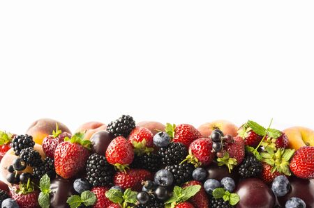 Mix berries and fruits on white background. Ripe blackberries, strawberries, blackcurrants and plums. Top view. Background berries and fruits. Various fresh summer fruits. Background of mix berries and fruits. Fresh berries close-up. Stok Fotoğraf