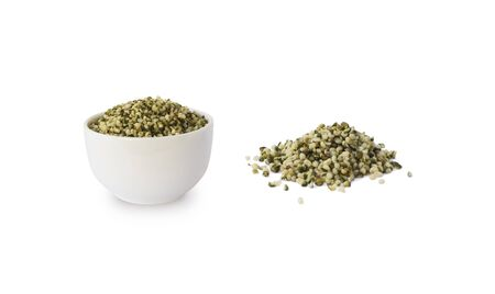 Hemp seeds isolated on white. Bowl with hemp seeds isolated on white background. Peeled raw hemp seeds in bowl.