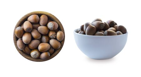 Hazelnuts isolated on white background. Hazelnuts in a bowl with copy space for text. Hazelnut close-up. Top view. 写真素材