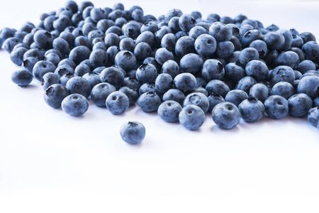 Fresh ripe blueberries with drops of dew. Macro photo. Fresh blueberry background. Texture blueberry berries close up. Ripe bilberry background. Texture bilberry berries close up. Top view. Berry back 写真素材