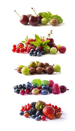 Set of fresh berries isolated a white. Currant, raspberry, cherry, strawberry, gooseberry, mulberry, bilberry, blueberry. Background of mix fruits with copy space for text.Assortment of summer berries. Different fresh berries isolated on white closeup shot.
