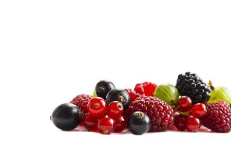 Ripe raspberries, gooseberries, blackberries, red and blackcurrants on white background. Background of mix fruits with copy space for text. Mix berries on white background. Red and black food. Red and black berries. Various fresh summer berries. Stock fotó