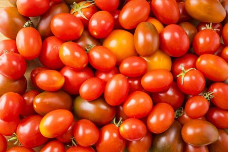 Red tomatoes background. Top view. Fresh organic tomatoes as background, closeup. Group of fresh tomatoes Stock fotó