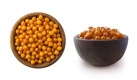 Sea buckthorn. Seabuckthorn in a wooden bowl isolated on white. Fresh ripe berry with leaves isolated on white background. Top view. Orang berry on white.