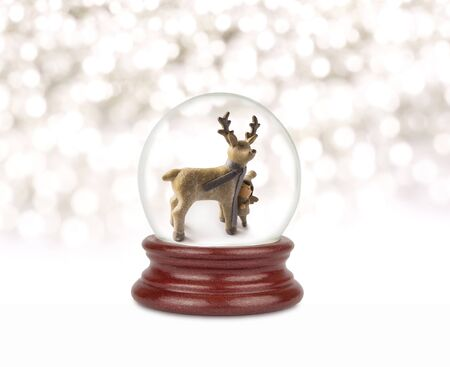 Christmas snow globe on white. Can be used as a Christmas or a New Year gift or symbol. Christmas and New Year design element. Toy glass snow globe with deer and baby. Snow ball on white. Stock fotó