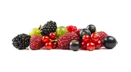 Ripe raspberries, gooseberries, blackberries, red and blackcurrants isolated on white background. Background of mix fruits with copy space for text. Mix berries on white background. Red and black food. Red and black berries. Various fresh summer berries.