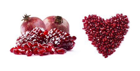 Pomegranate isolated on white background. Sweet and juicy garnet with copy space for text. Garnets isolated on white. Heart shape pomegranate seeds and two garnets fruit, isolated on white background. Stock fotó