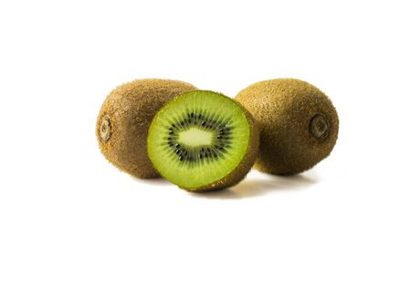 Kiwi fruit and slice isolated on white background. Tropical fruits on white. Kiwi with copy space for text. Stock fotó