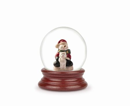 Christmas snow globe isolated on white. Can be used as a Christmas or a New Year gift or symbol. Christmas and New Year design element. Toy glass snow globe with snowman and bear. Snow ball on white.