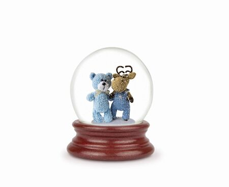 Christmas snow globe isolated on white. Can be used as a Christmas or a New Year gift or symbol. Christmas and New Year design element. Toy glass snow globe with teddy bear and deer. Snow ball on white.