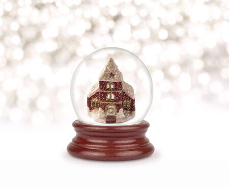 Christmas snow globe. Photo of church in a glass bowl. Christmas and New Year design element. Toy glass snow globe.