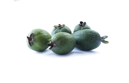 Green feijoa fruits isolated on white background.