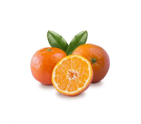 Ripe and tasty tangerines isolated on white background. Fresh clementines with copy space for text. Mandarin slice isolated on white background. 免版税图像