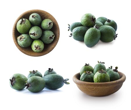 Green feijoa fruits in a wooden bowl isolated on white background. Top view. Fruits from different angles on white. Set of feijoa fruits. Stock fotó