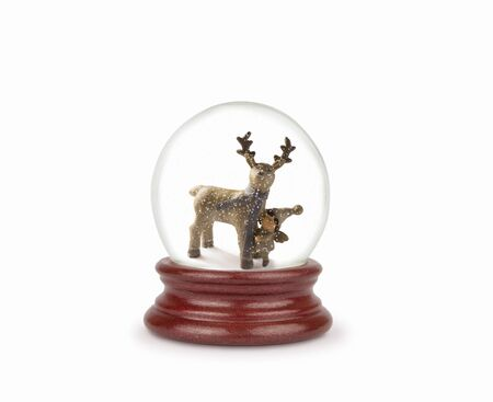 Christmas snow globe isolated on white. Can be used as a Christmas or a New Year gift or symbol. Christmas and New Year design element. Toy glass snow globe with deer and baby. Snow ball on white.