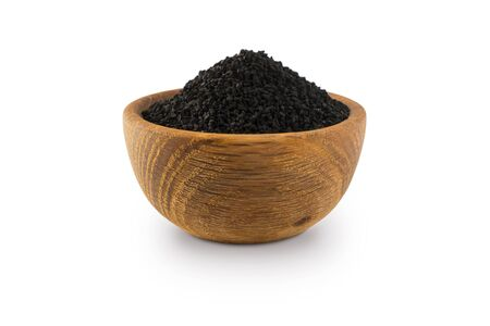 Black cumin isolated on white background. Black cumin seed in wooden bowl isolated on white background. Seeds with copy space for text. A pile of nigella sativa seed.