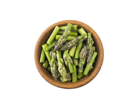 Asparagus isolated on white background. Asparagus with copy space for text on white. Fresh green spring vegetables on a white background. Edible Asparagus Sprouts.