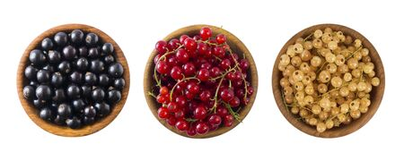 Set of different color currants isolated on white background cut out. White, red and black currant in a wooden bowl with copy space for text. Top view. 스톡 콘텐츠