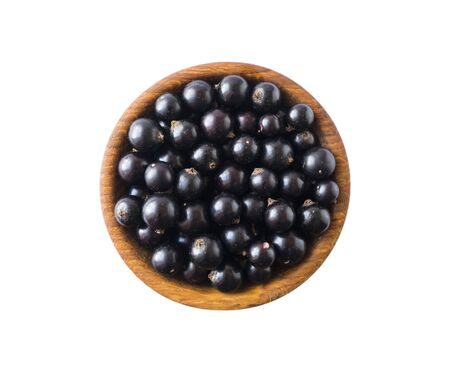 Black berries on white. Blackcurrants in a wooden bowl isolated on white background. Blackcurrant isolate. Blackcurrants isolated on white background. Top view. Berries closeup. Top view. 스톡 콘텐츠