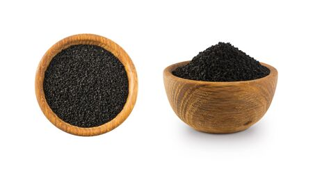 Black cumin isolated on white background. Black cumin seed in wooden bowl isolated on white background. SA pile of nigella sativa seed. Black cumin seed from different angles on white. Set of seeds.