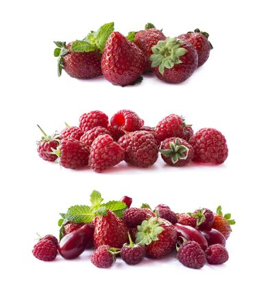 Ripe red berries isolated on white background.Juicy and delicious raspberries, strawberries and dogwoods. Background of mix fruits with copy space for text. Red berries and fruits.