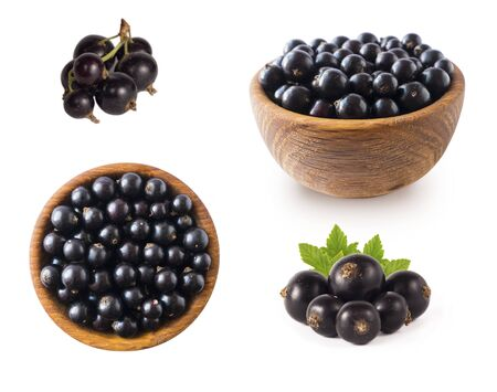 Black berries on white. Blackcurrants in a wooden bowl isolated on white background. Blackcurrant isolate. Blackcurrants isolated on white background. Top view. Berries from different angles on white. 스톡 콘텐츠