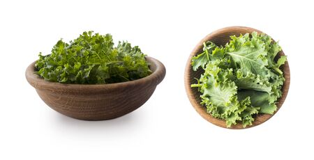 Kale leaves isolated on white background. Top view. Kale leaves with copy space for text. Herbs isolated on white. Kale in a wooden bowl on white background.