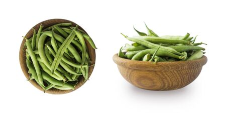Fresh green vegetables isolated on a white background. Green bean in wooden bowl. Vegetables with copy space for text. Haricot beanisolated on a white. Top view.