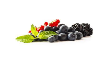 Fruits and berries isolated on white background. Fruits and berries with copy space for text. Red currants, blueberries and blackberries. Mix berries isolated on white background. Berries in cup on wh 스톡 콘텐츠