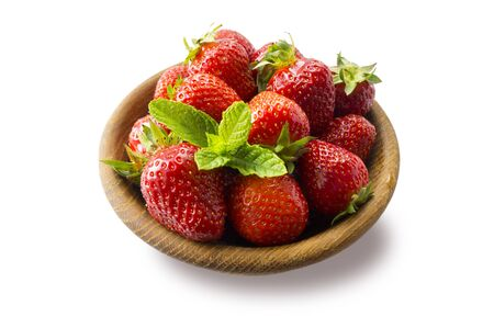 Strawberries in bowl isolated on white background. Ripe strawberries close-up. Background berry. Sweet and juicy berry with copy space for text. Strawberries on white background. Various fresh summer  스톡 콘텐츠
