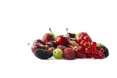Fruits, berries isolated on white background. Fruits and berries with copy space for text. Currant, strawberry, cherry, mulberry, raspberry. Mixed berries isolated on white background.Berries close-up
