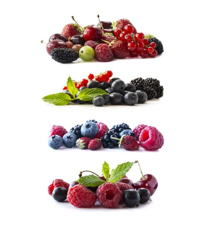 Ripe berries and fruits isolated on white background.Juicy and delicious berries and fruits on white background. Mixed fruit and berry with copy space for text.Set of mixed berry from different angles Imagens