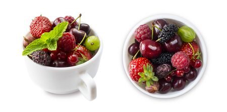 Top view.Fruits and berries in bowl isolated on white background. Mixed fruits with copy space for text. Mixed berries isolated on a white background.Fruits and berries from different angles on white.
