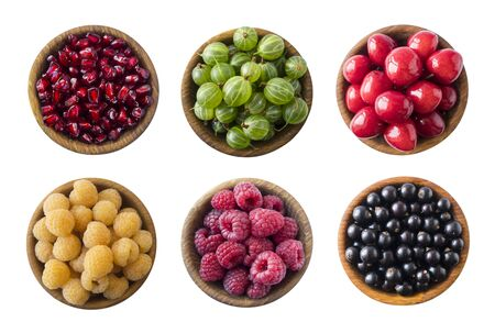 Top view. Fruits and berries in bowl on white background. Fruits with copy space for text. Collage of different fruits and berries isolated on a white background. Fruits and berries isolated on white. Imagens
